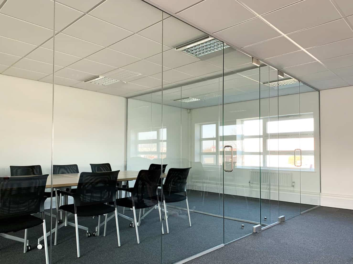 single glazed partition with frameless glass door