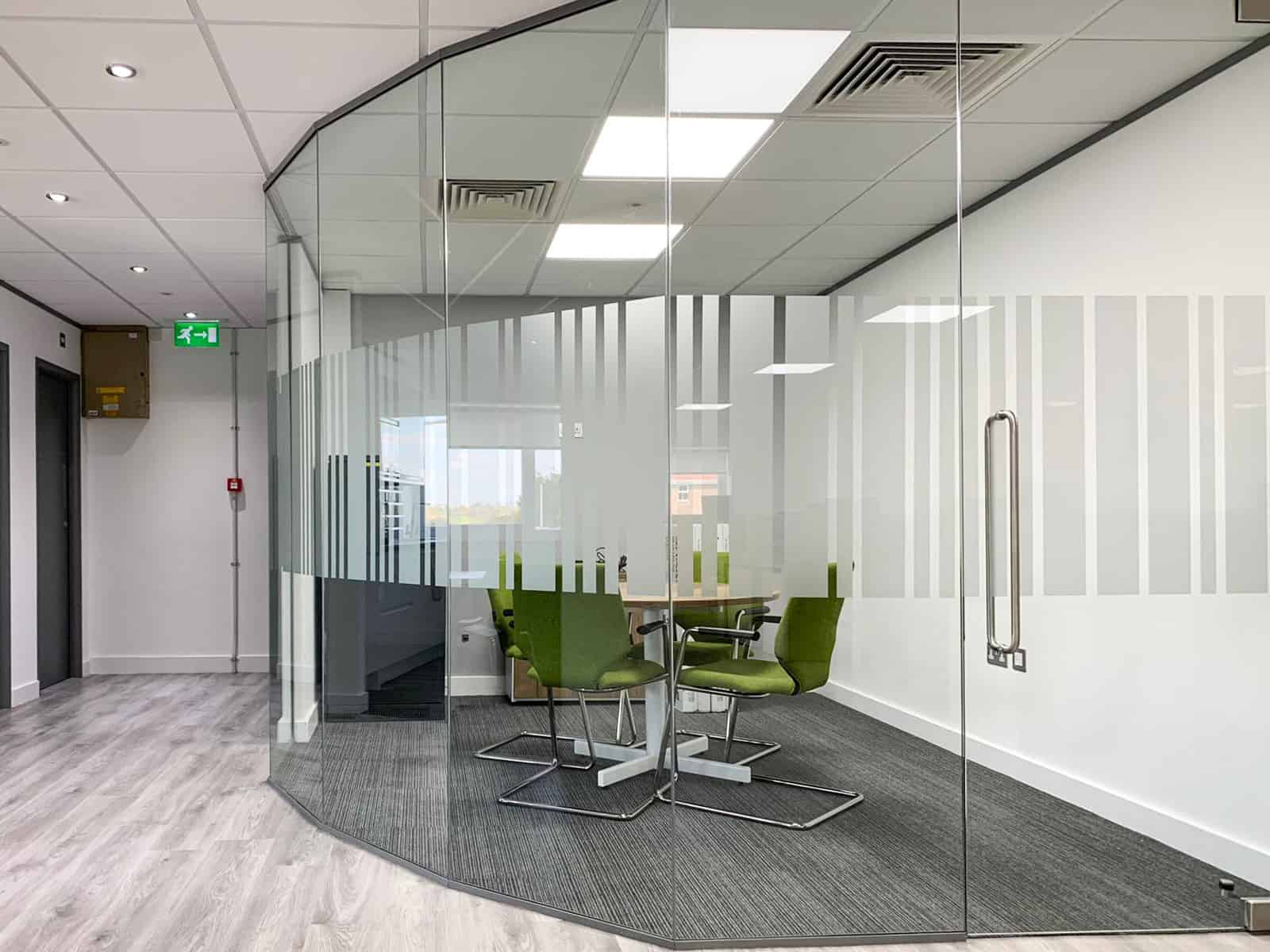 faceted glass partition with frameless glass door