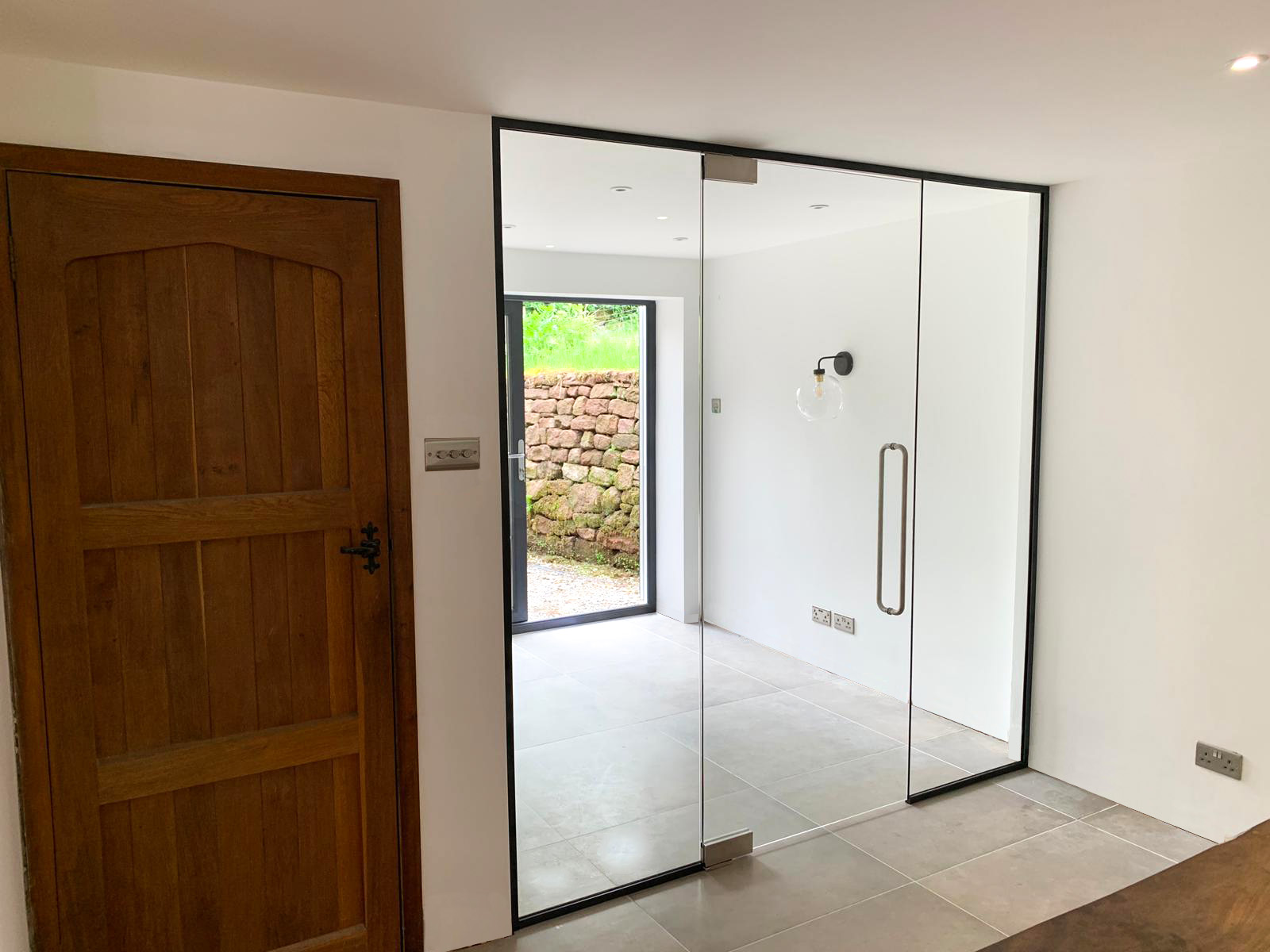 single glazed partition with full height glass door